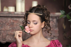 The young girl in a medieval dress with a rose  Stock Images