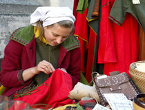 Young girl in medieval dress in Tallinn royalty free stock image