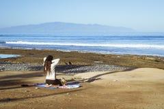 Young girl meditates sitting Royalty Free Stock Image
