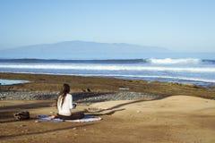 Young girl meditates sitting Royalty Free Stock Photo