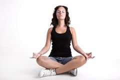 Young girl meditating. A young girl meditating in her every day attire Royalty Free Stock Photography