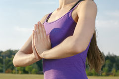 Young girl meditating outdoor. Young girl in workout gear meditating in the park Royalty Free Stock Photos