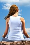 Young girl meditating outdoors Royalty Free Stock Image