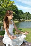 Young girl meditating in the park Royalty Free Stock Image