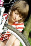 Young girl mends bicycles Royalty Free Stock Photography