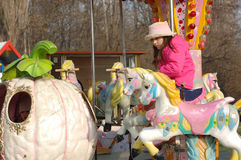 Young girl on merry go round Stock Photography