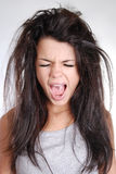 Young girl with messy hair screaming Royalty Free Stock Image
