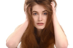 Young girl with messy long brown hair. Stock Image