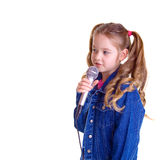 Young girl with microphone. Young girl singing with microphone Stock Image