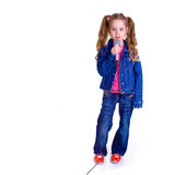 Young girl with microphone. On white background Stock Images