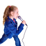 Young girl with microphone. On white background Royalty Free Stock Photography