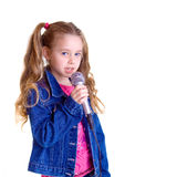 Young girl with microphone. On white background Stock Photography