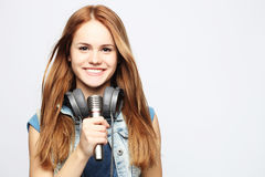 Young girl with microphone sings Stock Photo