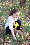 Young girl in the middle of daffodils Royalty Free Stock Photos