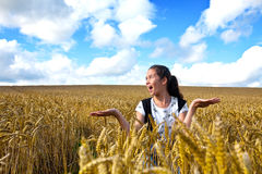 Young girl in the middle of a wheat field. royalty free stock photo