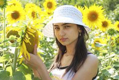 Young girl in the midle of  sunflower field Royalty Free Stock Image