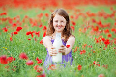Young girl with milk Stock Images