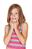 Young girl mimic a smile. A young pretty girl stretched her mouth with her fingers to Royalty Free Stock Photography