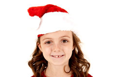 Young girl missing tooth smiling wearing santa hat Stock Photos