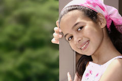 young girl of mix parentage on a garden terrace Stock Photo