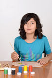 Young girl mixing art paints Stock Image
