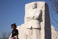 Young girl at MLK Memorial. Young girl smiling in front of a monument for Martin Luther King Jr in Washington DC Stock Images
