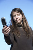 Young girl with a mobile phone Royalty Free Stock Photography