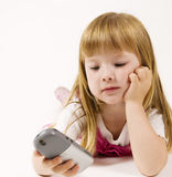 Young girl with mobile phone Royalty Free Stock Photos
