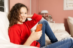 Young girl mobile phone Royalty Free Stock Image