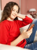 Young girl mobile phone Royalty Free Stock Photography