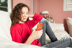 Young girl mobile phone. An image of a young girl with a mobile phone Stock Photography