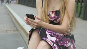 Young girl with a mobile phone outdoors stock footage