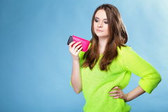 Young girl with mobile phone in pink cover Royalty Free Stock Image