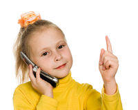 Young girl with mobile phone shows a finger up Royalty Free Stock Photography