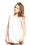 Young girl model. In white dress with patterns Stock Photography