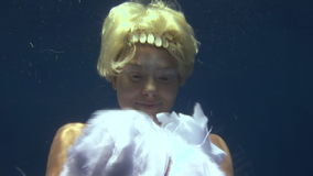 Young girl model underwater white angel costume on blue background in Red Sea. stock footage