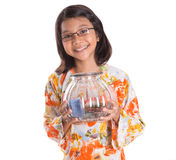 Young Girl With Money Jar I Stock Image
