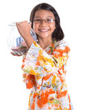 Young Girl With Money Jar III Royalty Free Stock Photo