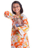 Young Girl With Money Jar IX Stock Photography