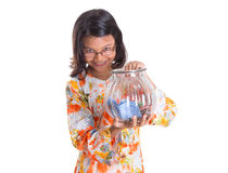 Young Girl With Money Jar VIII Stock Image