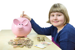 Young girl with money and piggy bank Stock Photography