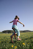 Young girl on monocycle Stock Photography