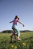Young girl on monocycle Stock Photography