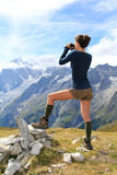 Young girl  with Mont Blanc panorama. Young girl on top of the Mont Sapin with binocular , famous Mont Blanc in background . Vertical shot Stock Photos
