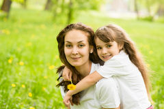 Young girl with mother in park stock image