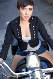 Young girl in Alley on Large V-Twin Motorcycle Royalty Free Stock Photo