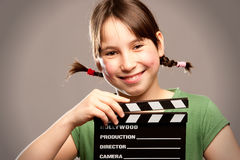 Young girl with movie clapper board Royalty Free Stock Photos