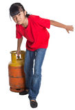 Young Girl Moving Cooking Gas Cylinder II Royalty Free Stock Photo