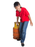 Young Girl Moving Cooking Gas Cylinder III Royalty Free Stock Photography