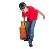 Young Girl Moving Cooking Gas Cylinder IV Stock Image